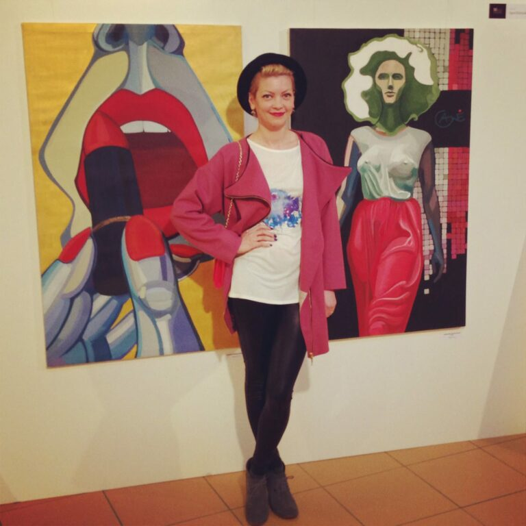 Artist Agne Kisonaite during exhibition with her painting 'Ritual'