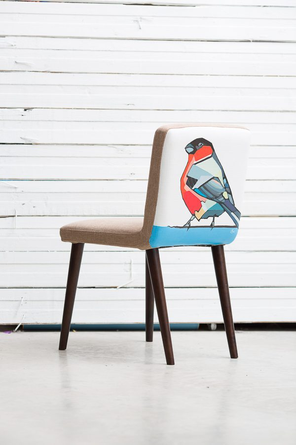 Painting 'Bullfinch' on a back of chair. Artist Agne Kisonaite.