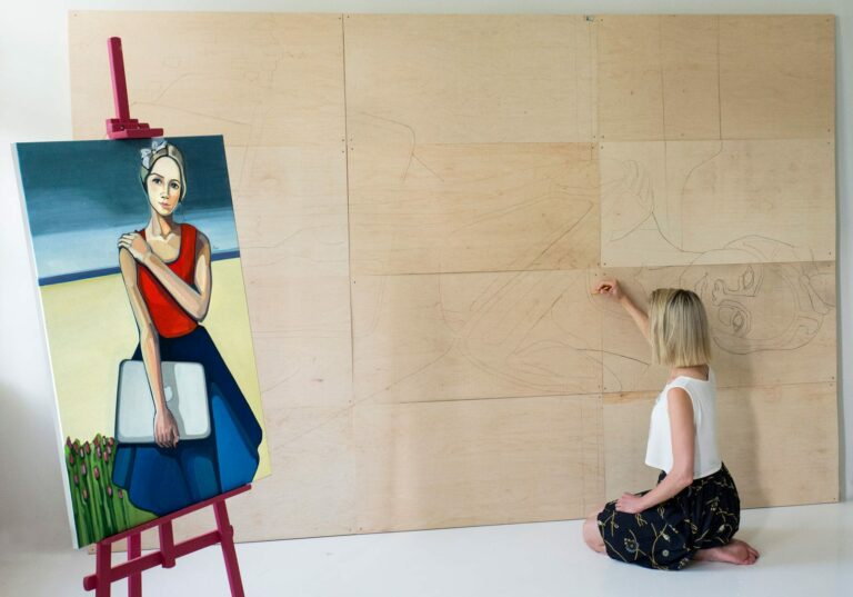 Transferring painting 'Modern Lithuanian' to a large desk. Author - artist Agne Kisonaite