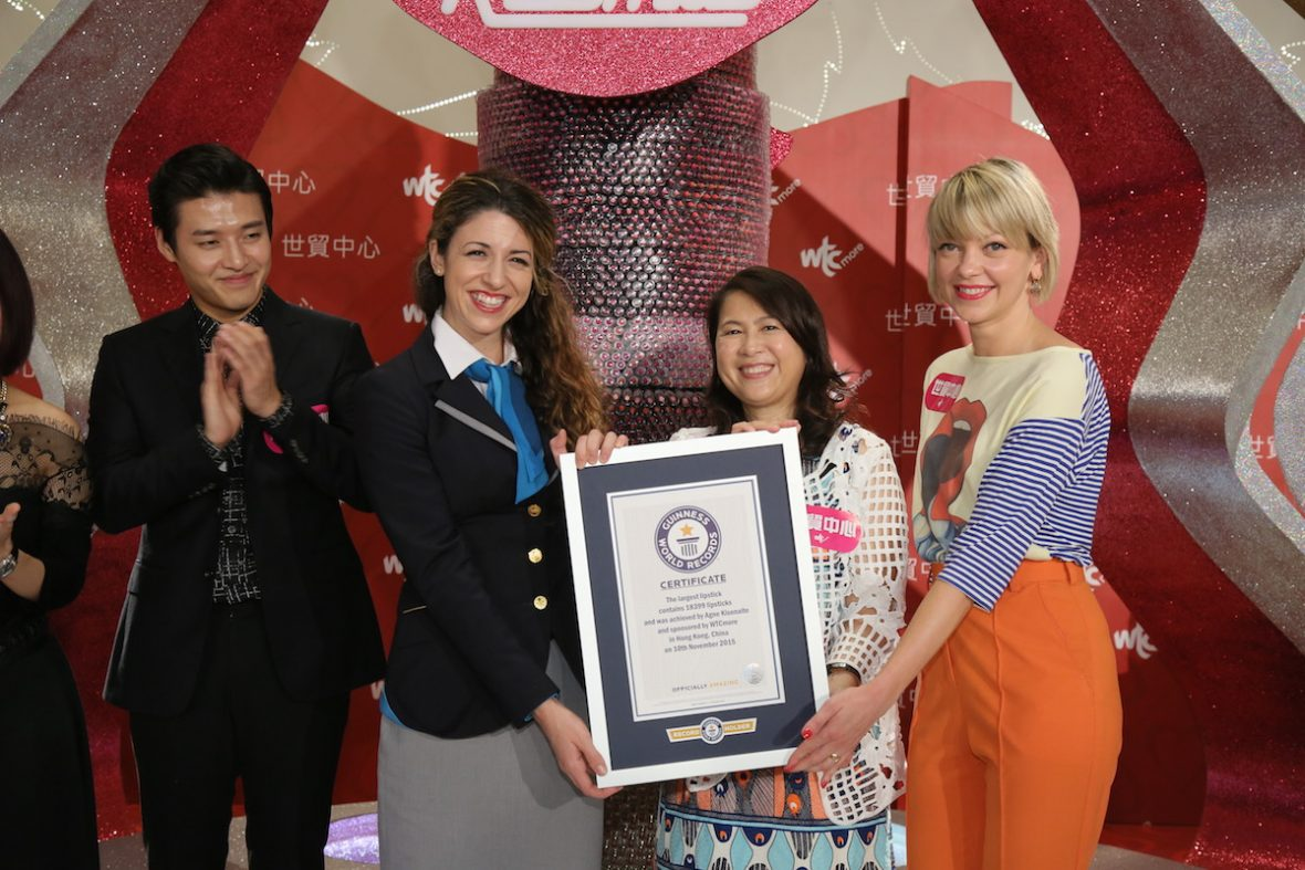 Agne Kisonaite holding Guinness world record certificate