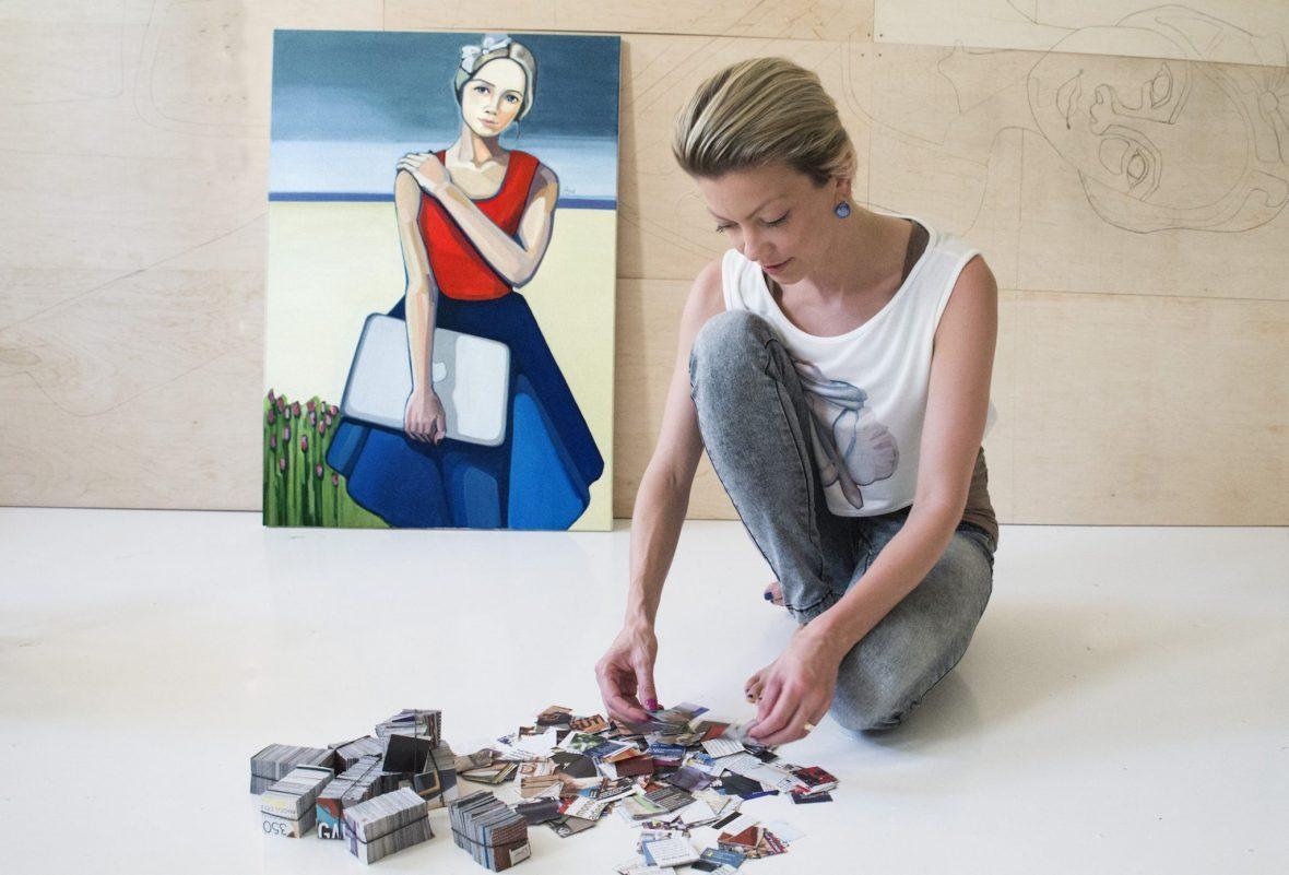 """Artist Agne Kisonaite making of collage """"Modern Lithuanian'"""